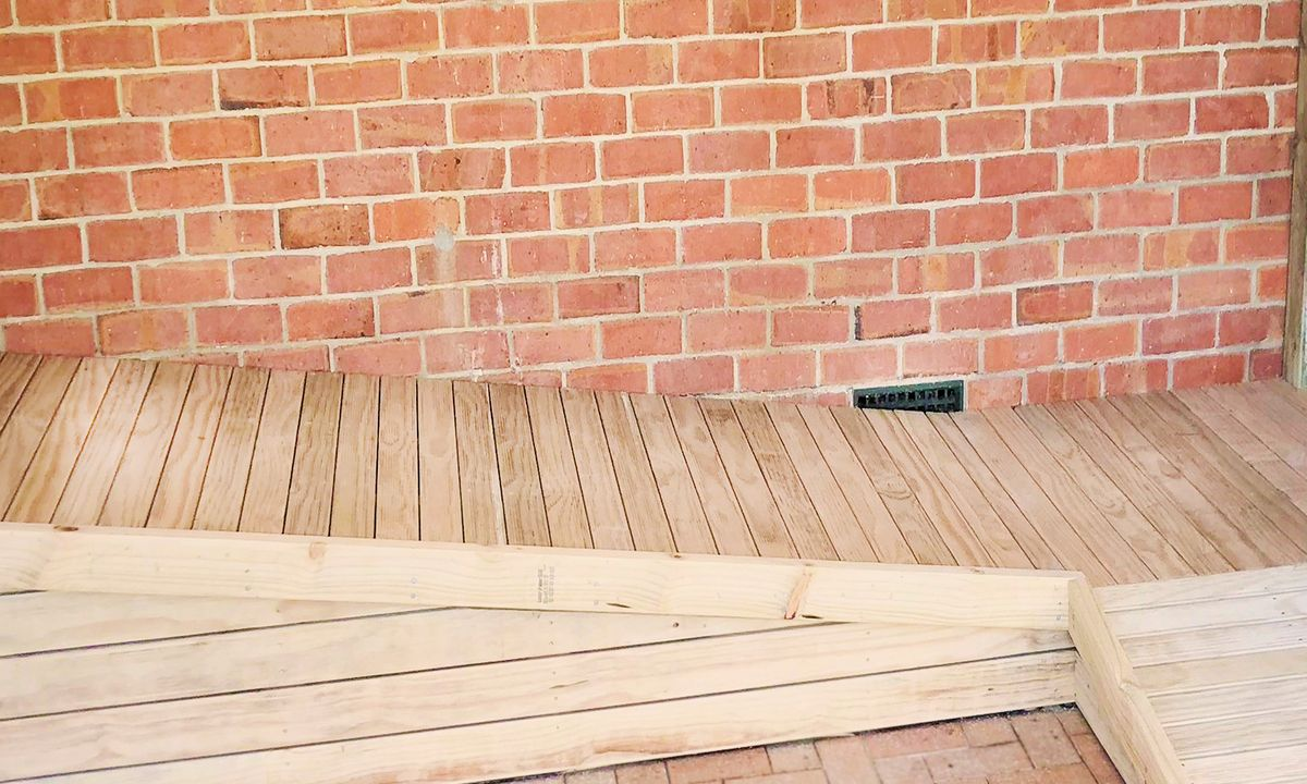 Height adjustable Nurajacks created slope suitable for home made wheelchair ramp
