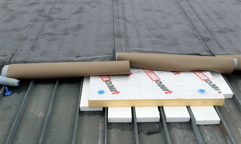 Nuratherm system being overlaid on existing metal tray roof